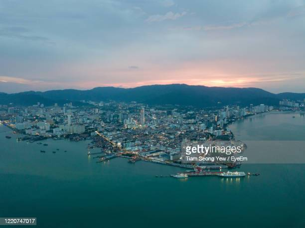aerial view of city at waterfront - association of southeast asian nations stock pictures, royalty-free photos & images