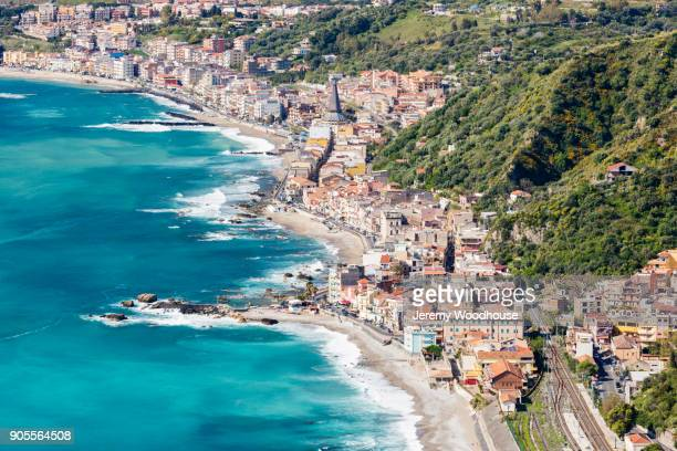 aerial view of city at waterfront - taormina stock pictures, royalty-free photos & images
