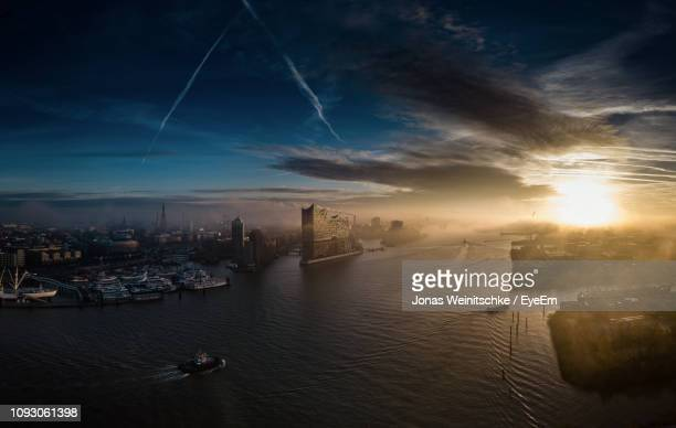 aerial view of city buildings against sky during sunset - hamburg stock-fotos und bilder