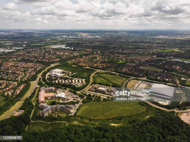 aerial view of city buildings against sky - northamptonshire stock pictures, royalty-free photos & images