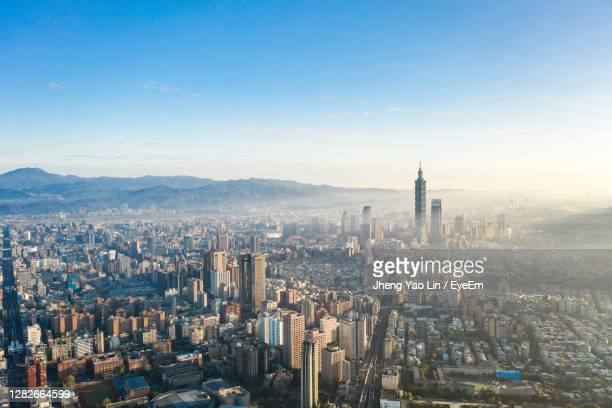aerial view of city buildings against sky - taiwan stock pictures, royalty-free photos & images