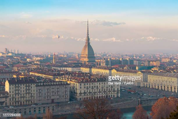 aerial view of city buildings during sunset - turin stock pictures, royalty-free photos & images