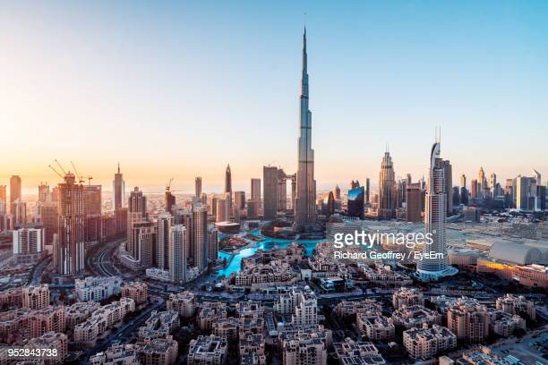 aerial view of city buildings during sunset - united arab emirates stock pictures, royalty-free photos & images