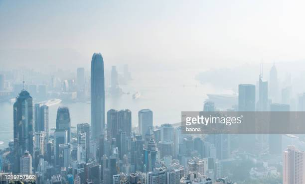 aerial view of city buildings in foggy day - air pollution stock pictures, royalty-free photos & images