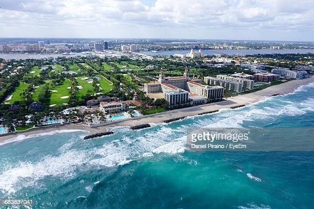 aerial view of city by lake worth inlet against sky - fort lauderdale stock pictures, royalty-free photos & images