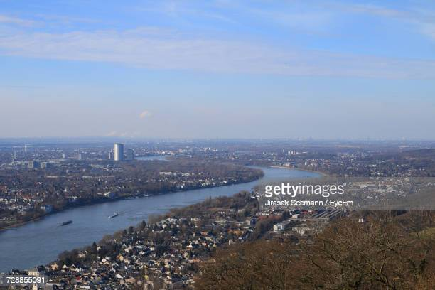 Aerial View Of City By River Against Sky