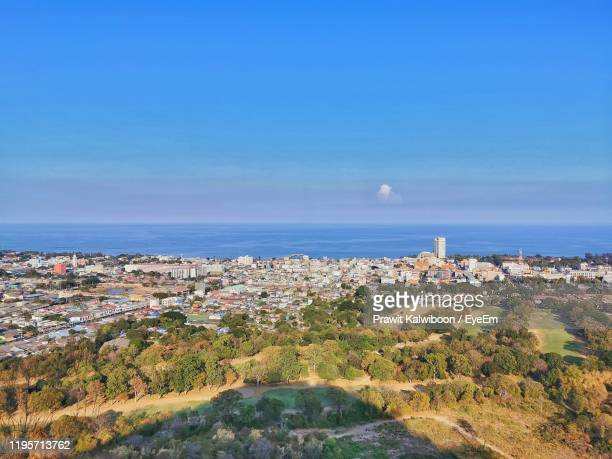 aerial view of city by sea against blue sky - prachuap khiri khan province stock pictures, royalty-free photos & images