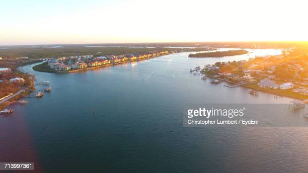 Aerial View Of City By Sea Against Clear Sky