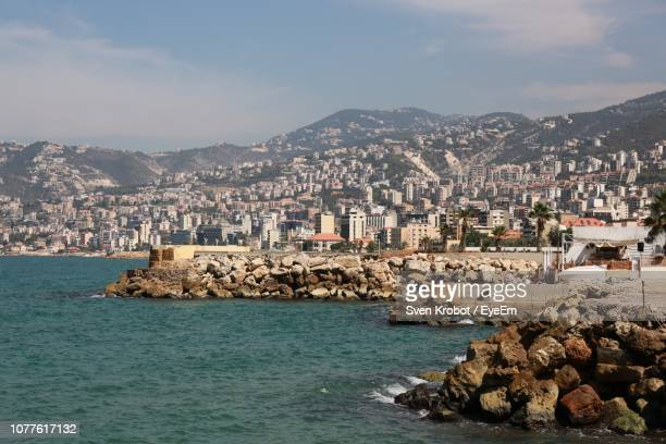 aerial view of city by sea against sky - beirut stock pictures, royalty-free photos & images