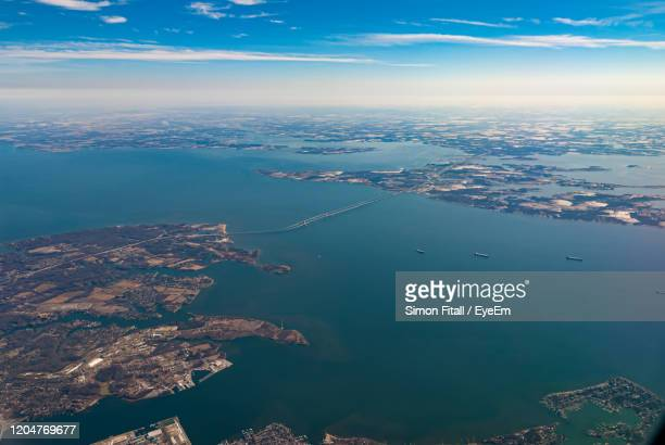 aerial view of city by sea against sky - bay bridge stock pictures, royalty-free photos & images