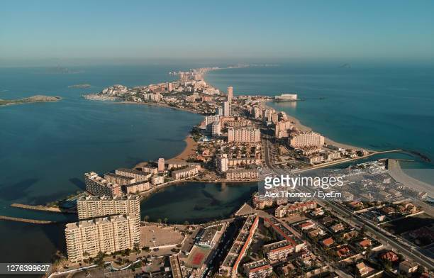 aerial view of city by sea against sky - la manga stock pictures, royalty-free photos & images