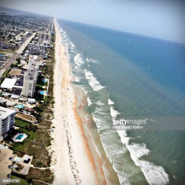 aerial view of city by sea against sky - baum stock pictures, royalty-free photos & images