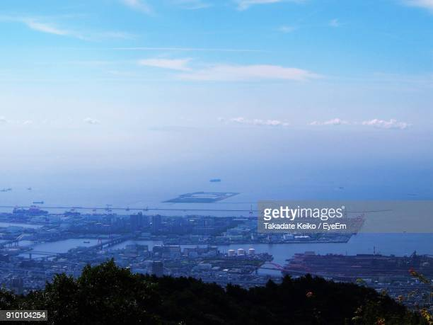 aerial view of city by sea against sky - 神戸市 ストックフォトと画像