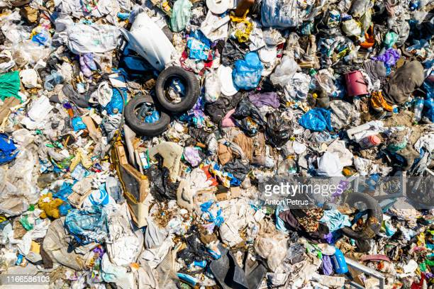 aerial view of city dump or landfill.  pollution concept, top view. - landfill stock pictures, royalty-free photos & images