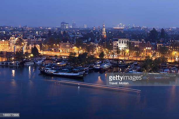 Aerial view of city harbour at night, Amsterdam, The Netherlands