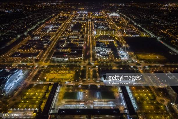 aerial view of city lit up at night - milton keynes stock pictures, royalty-free photos & images