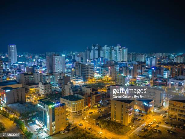 aerial view of city lit up at night - jeonju stock pictures, royalty-free photos & images