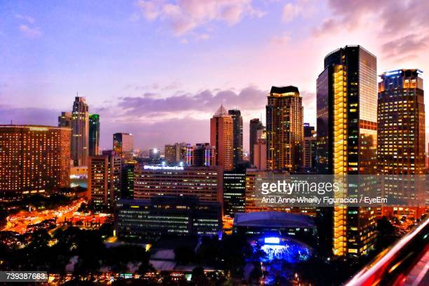 aerial view of city lit up at night - makati stock photos and pictures