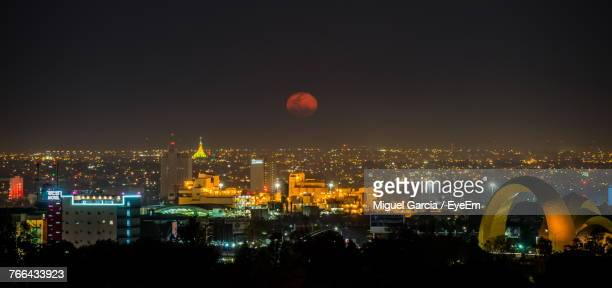 aerial view of city lit up at night - guadalajara mexico stock pictures, royalty-free photos & images