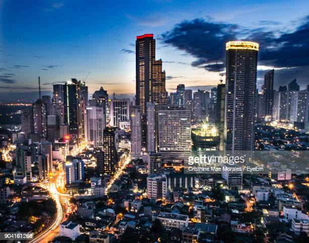 aerial view of city lit up at night - manila philippines stock pictures, royalty-free photos & images