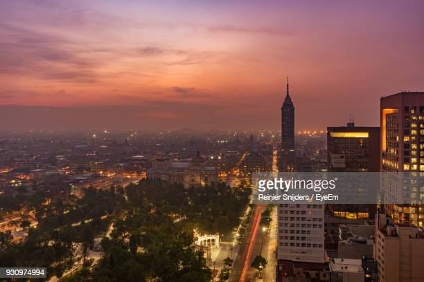 aerial view of city lit up at sunset - mexico city skyline stock pictures, royalty-free photos & images