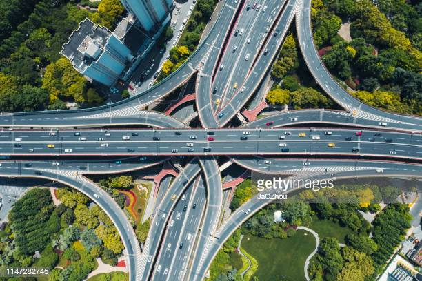 aerial view of city motorway junction - interchange stock pictures, royalty-free photos & images