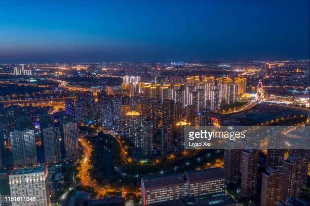 aerial view of city night - liyao xie stock pictures, royalty-free photos & images