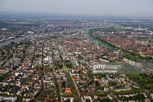 Aerial view of city on right bank of Rhine River at mouth of Neckar River.