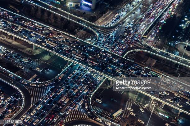 aerial view of city overpass at rush hour - traffic jam stock pictures, royalty-free photos & images