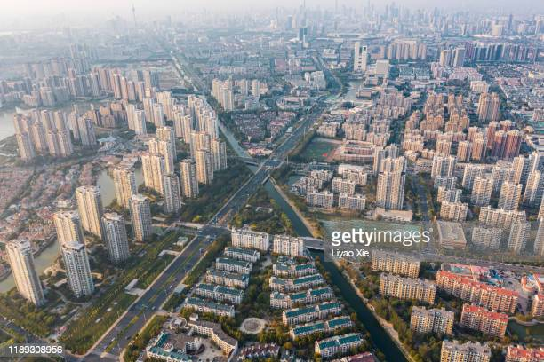 aerial view of city - liyao xie stock-fotos und bilder