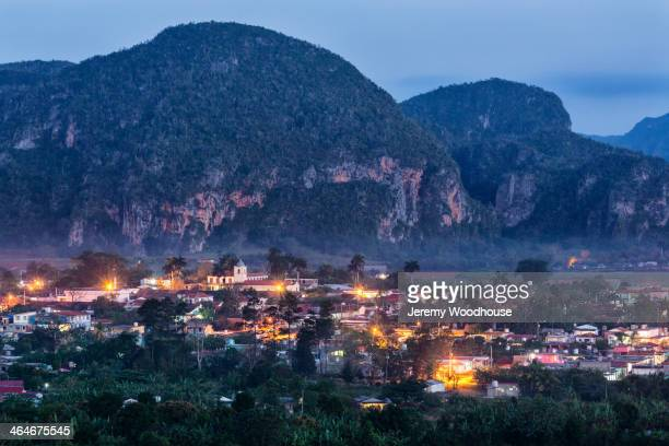 aerial view of city rooftops lit up at night, vinales, pinar del rio, cuba - pinar del rio stock photos and pictures