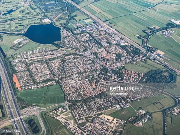 aerial view of city seen through airplane window - bortes stock-fotos und bilder