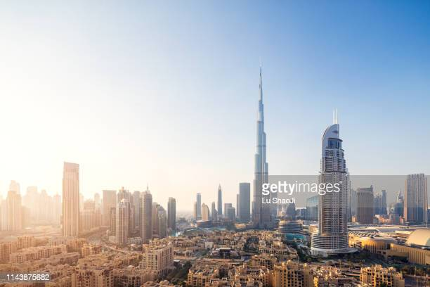 aerial view of city skyline and cityscape at sunset in dubai.uae - ブルジュハリファ ストックフォトと画像