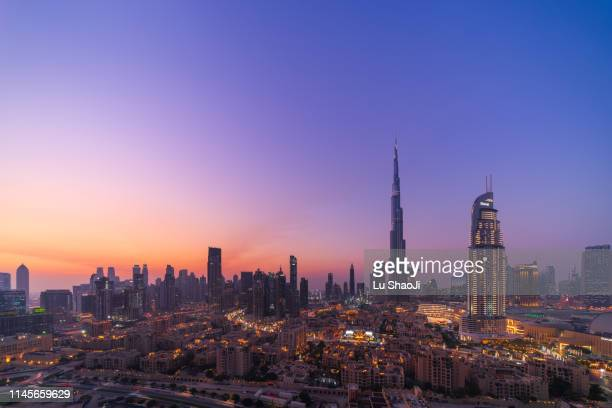 aerial view of city skyline and cityscape at sunset in dubai.uae - dubai stock pictures, royalty-free photos & images