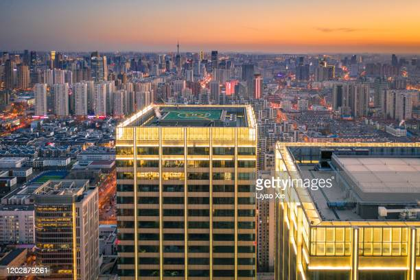 aerial view of city skyline - liyao xie stock pictures, royalty-free photos & images