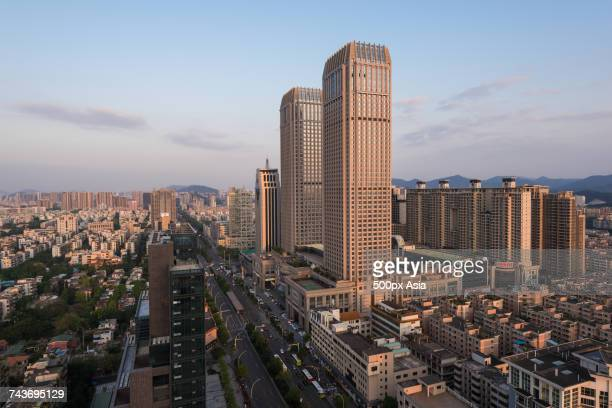 aerial view of city with buildings and skyscrapers, zhongshan, guangdong, china - zhongshan stock-fotos und bilder