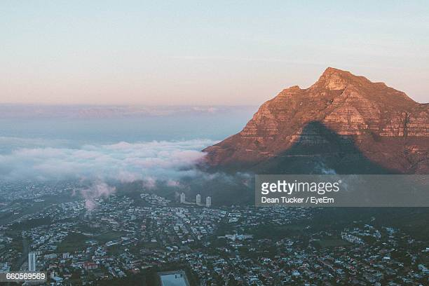 Aerial View Of City With Mountain Peak