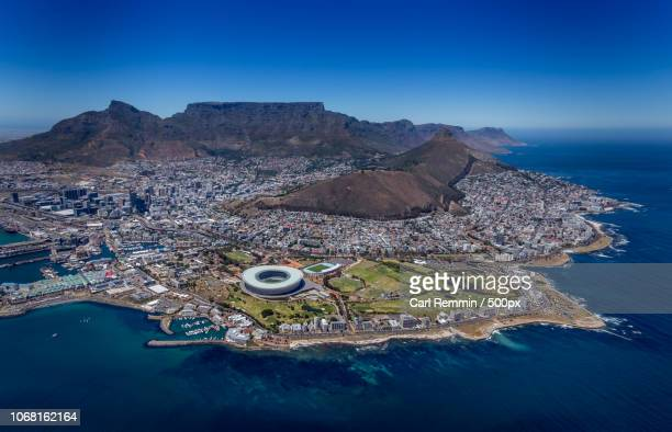 aerial view of city with table mountain and ocean, cape town, south africa - table mountain stock pictures, royalty-free photos & images