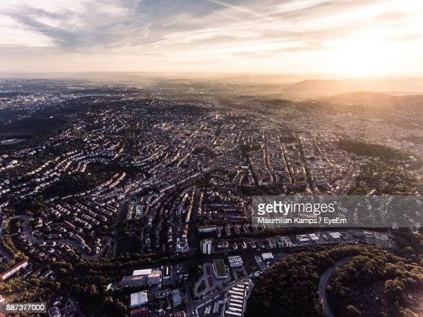aerial view of cityscape against cloudy sky during sunset - stuttgart stock pictures, royalty-free photos & images
