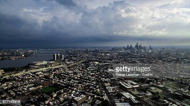 Aerial View Of Cityscape Against Cloudy Sky In Stormy Weather