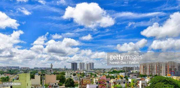 aerial view of cityscape against cloudy sky - bangalore stock pictures, royalty-free photos & images