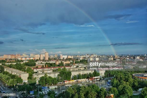 aerial view of cityscape against cloudy sky - krasnodar stock pictures, royalty-free photos & images