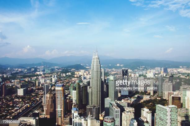 aerial view of cityscape against cloudy sky - bandar seri begawan stock photos and pictures