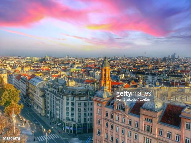 aerial view of cityscape against cloudy sky - vienna austria stock pictures, royalty-free photos & images