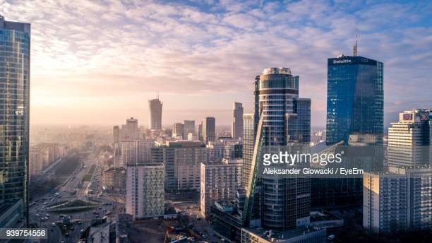 aerial view of cityscape against cloudy sky - warsaw stock pictures, royalty-free photos & images