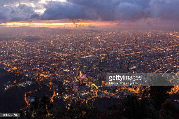 aerial view of cityscape against sky at sunset - bogota stock pictures, royalty-free photos & images