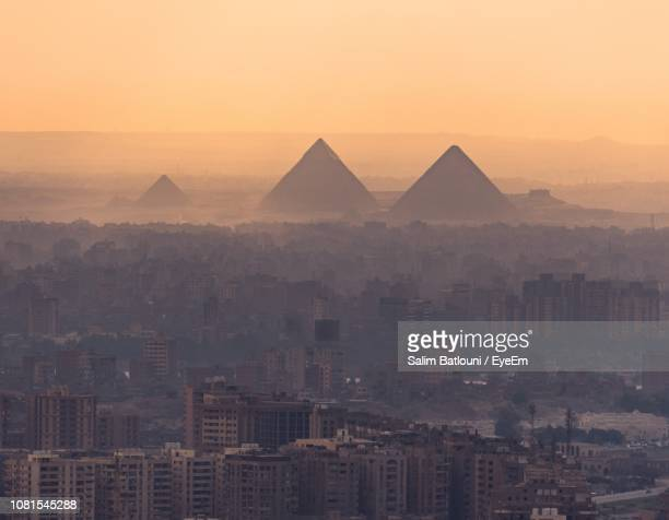 aerial view of cityscape against sky during sunset - cairo stock pictures, royalty-free photos & images