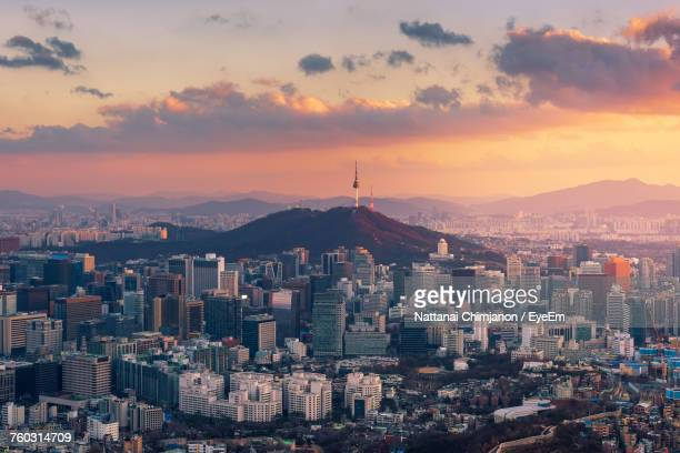 aerial view of cityscape against sky during sunset - seoul stock pictures, royalty-free photos & images