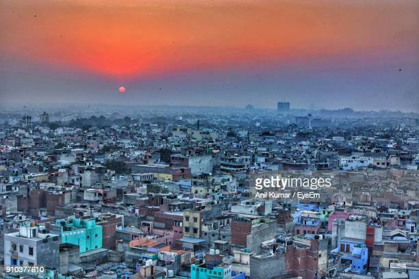 aerial view of cityscape against sky during sunset - delhi stock pictures, royalty-free photos & images