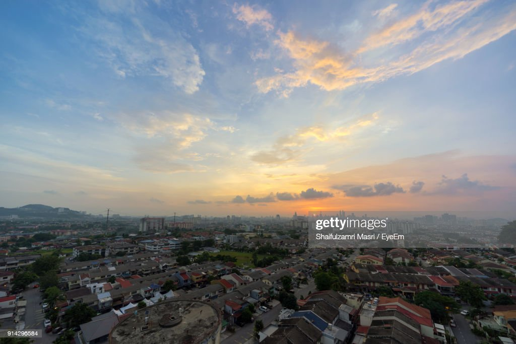 Aerial View Of Cityscape Against Sky During Sunset : Stock Photo